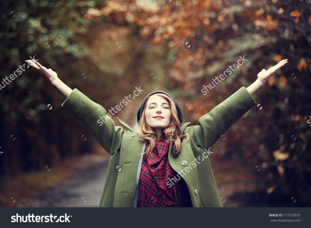stock-photo-style-redhead-girl-at-beautiful-autumn-alley-117519970